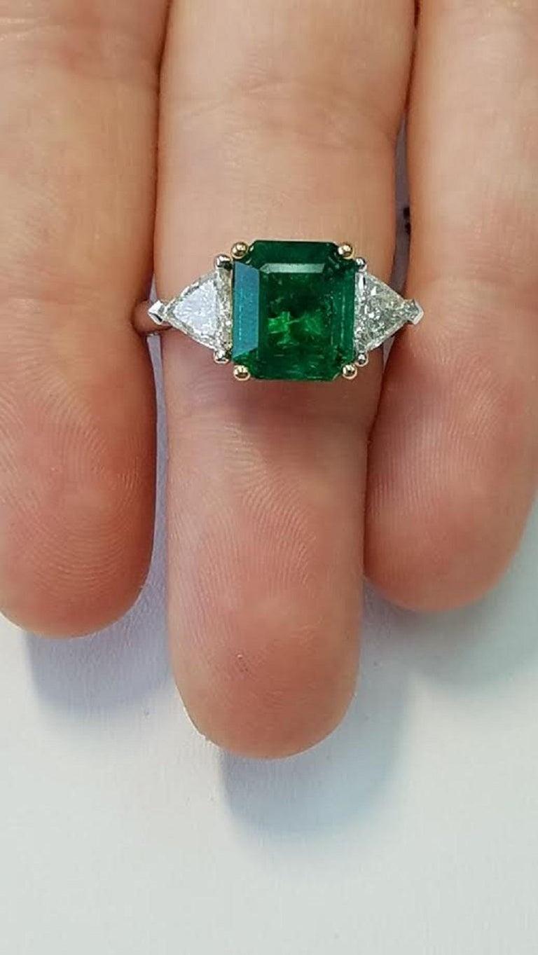 Platinum/ 18 Karat Yellow Gold Emerald Cut Emerald and Diamond Rings 4.13 Carats of Emeralds 0.83 Carats of Triangular Diamonds 0.18 Carats of Round Diamonds Emerald Cut  Platinum/18 Karat Yellow Gold