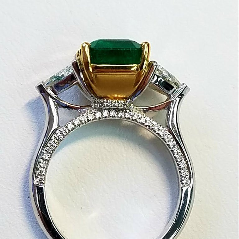 Three-Stone Platinum/ 18 Karat Yellow Gold Emerald Cut Emerald and Diamond Ring In New Condition For Sale In Great Neck, NY