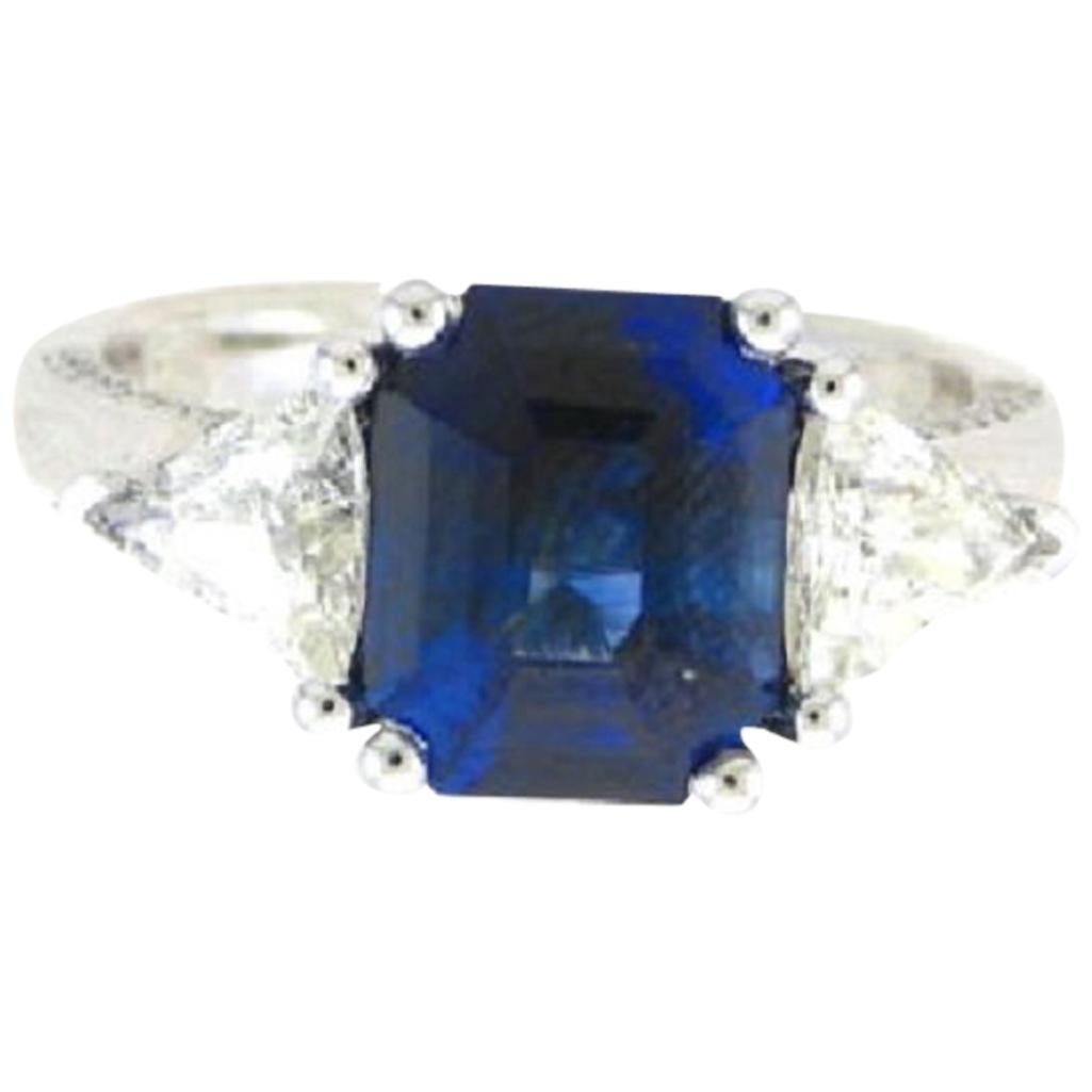 GIA Certified 4.49 Carat ThreeStone Platinum Emerald Cut Sapphire & Diamond Ring