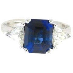 GIA Certified 4.49 Carat ThreeStone Platinum Emerald Cut Sapphire & Diamond Ring