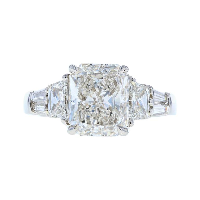 Three -Stone Radiant Cut Diamond Engagement Ring with Trapezoid Side Stones For Sale