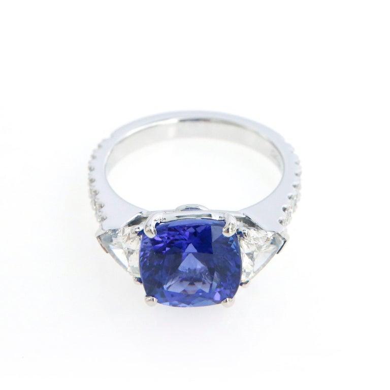 Women's Three-Stone Ring with 3.62 Carat Tanzanite and Trillion Cut Diamonds For Sale