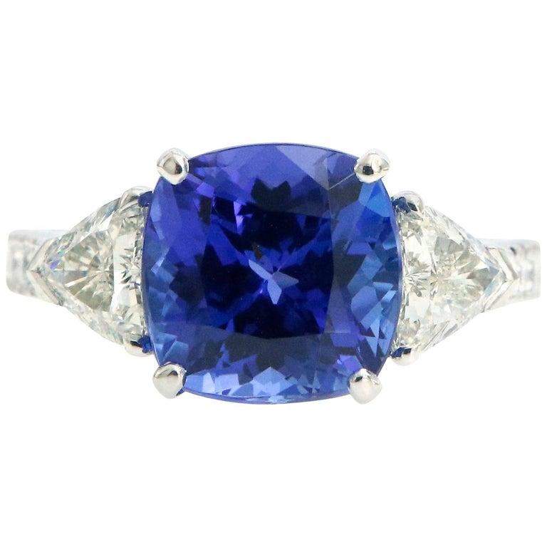 Three-Stone Ring with 3.62 Carat Tanzanite and Trillion Cut Diamonds For Sale