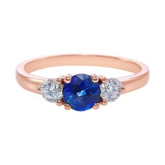 Three-Stone Ring with Blue Sapphire and Round Brilliant Cut Diamond in Rose Gold