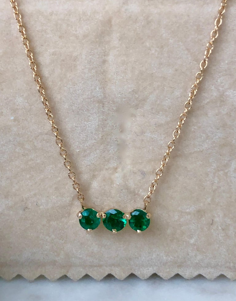 Stunning 3 Colombian AAA emerald, VS- Clarity. Set in Gorgeous Three Stone Pendant Chain Fashion Necklace. Total Colombian Emerald Weight 1.00 Carat. 14K yellow gold 3.2g. Length 18