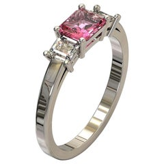 Three Stones Radiant Cut Pink Sapphire and Emerald Cut Diamond in Platinum Ring