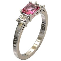 Three Stones Radiant Cut Pink Sapphire and Emerald Cut Diamond in Platinum Ring