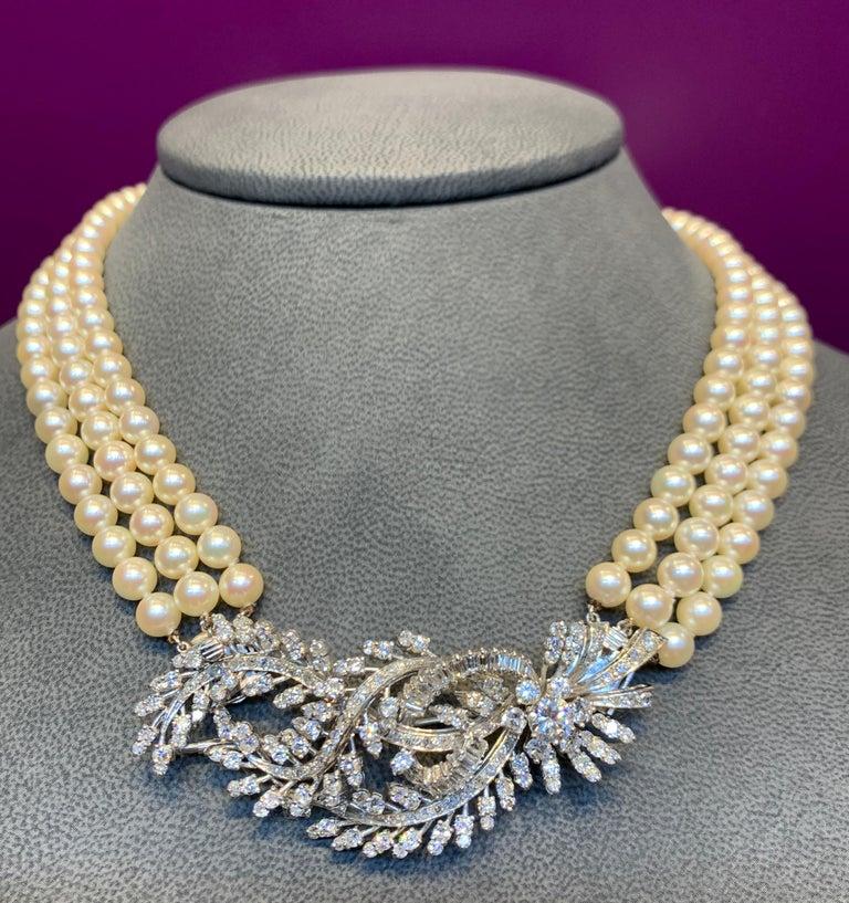 Three Strand Pearl & Diamond Necklace  Center diamond element is convertible to a diamond brooch.  168 small round cut diamonds 21 baguette cut diamonds  6 medium round cut diamonds  1 large round cut diamond  Total Diamond weight approximately 5