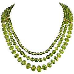 Three Strands of Fine Peridot Beads with 18 Karat Gold and a Diamond Clasp