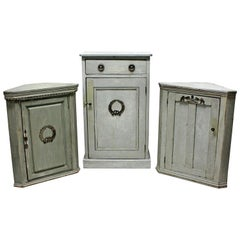 Three Swedish Painted Cupboards with Silver Mounts