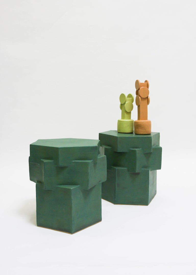Low three-tier matte green ceramic side table for indoor or outdoor use in warm climates year round. Great next to a pool for a low lounge chair, not meant for winter outdoor use. Unlimited edition, individual side tables are unique in size, glaze,