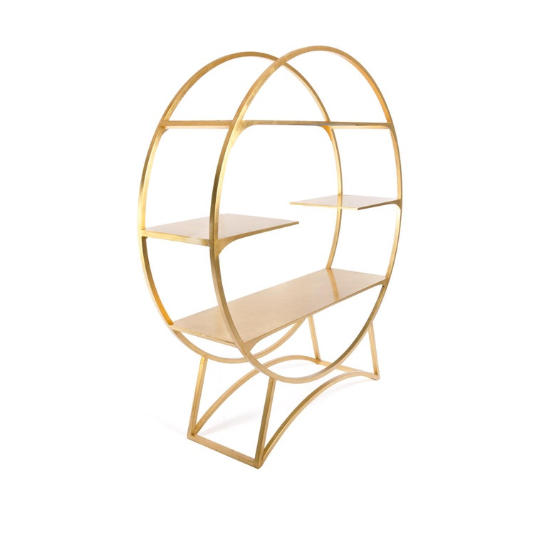 With its elegant lines and bright golden leaf hand-finish, the Oversized Orb is an eye-catching display piece perfect for showcasing personal treasures or retail wares. It looks as lovely against a wall as it does in the center of a room as a
