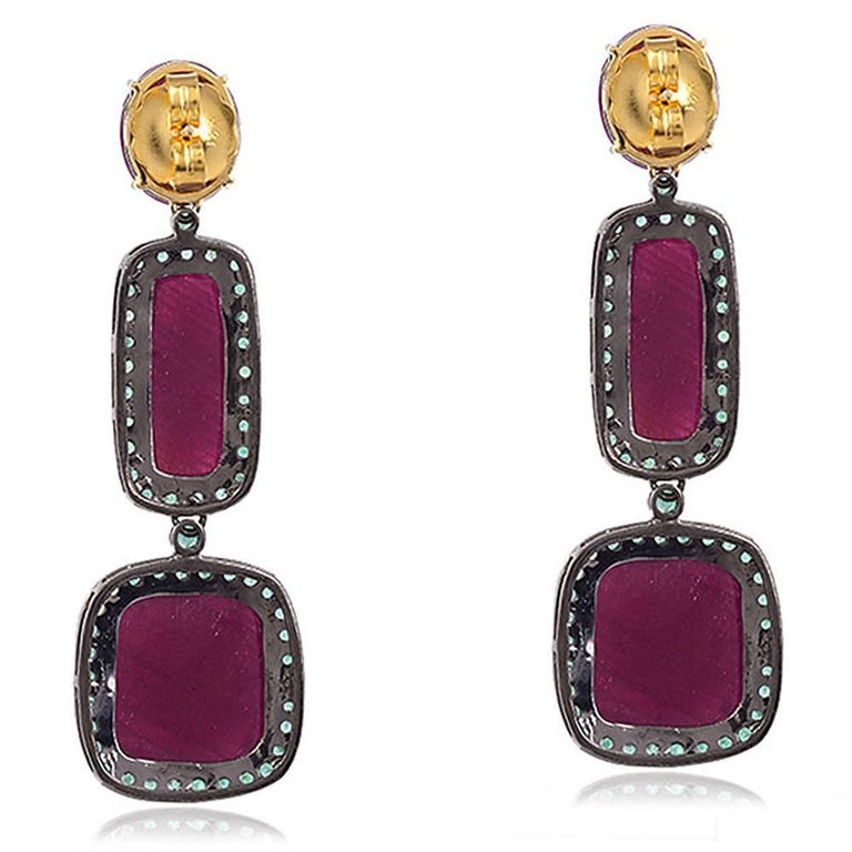 This 3 tier bright and ravishing ruby earring with emeralds around is one of a kind with oval, rectangle and square rubies.   18KT:2.97gms SI:8.92g EMERALD:2.8ct RUBY:50ct