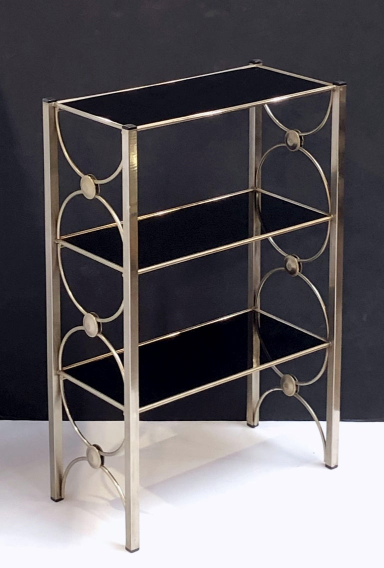 English Three-Tiered Shelves or Étagère of Metal and Black Glass For Sale