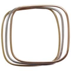 Three Tri-Color 18 Carat Gold Bangles