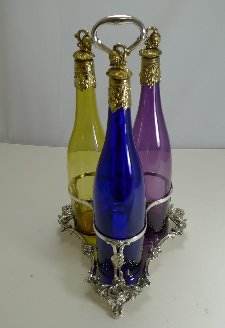 Three Victorian Coloured Glass Decanters in Stand, circa 1890 For Sale 5