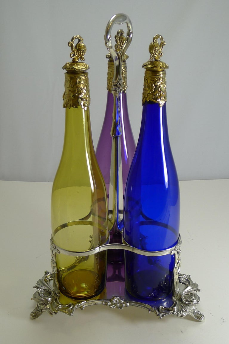 Three Victorian Coloured Glass Decanters in Stand, circa 1890 For Sale 6