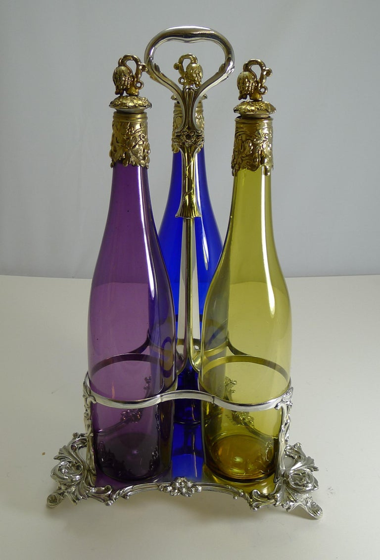 Three Victorian Coloured Glass Decanters in Stand, circa 1890 For Sale 7