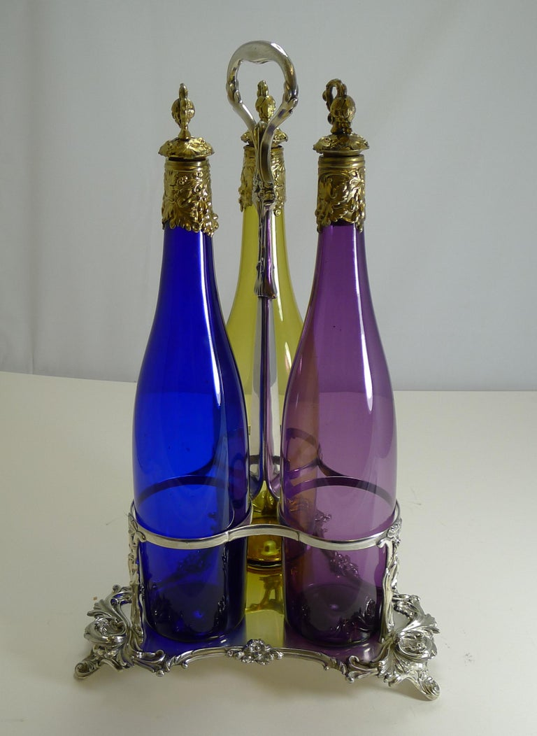 Three Victorian Coloured Glass Decanters in Stand, circa 1890 For Sale 8
