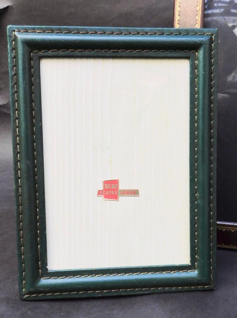 Three leather photo frames from the 1970s. The larger frame is Italian with glass and the other two are Belgian and have no glass. The measurement shown is for the largest frame, the other two Measures: Small 16.50 x 12.50 cm (6-1/2
