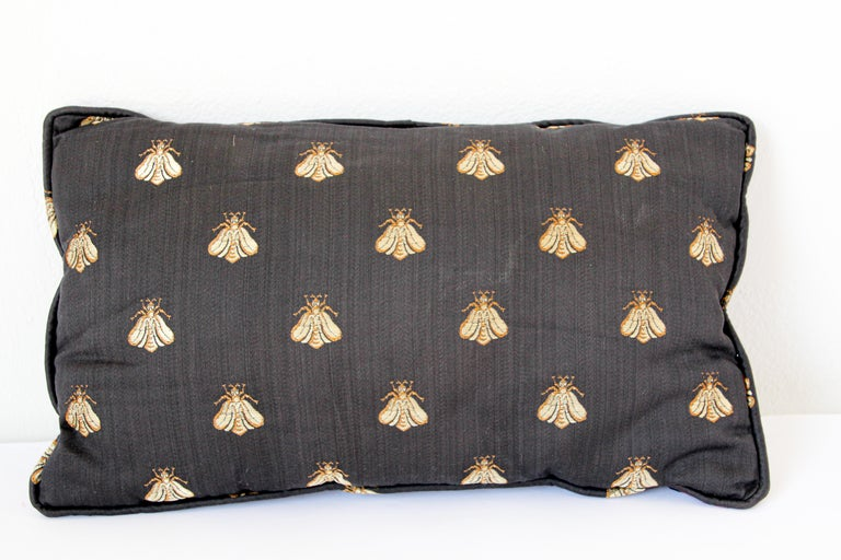 Throw decorative accent black raw silk pillow embellished with gold bees designs. Decorative twisted trims all around.
