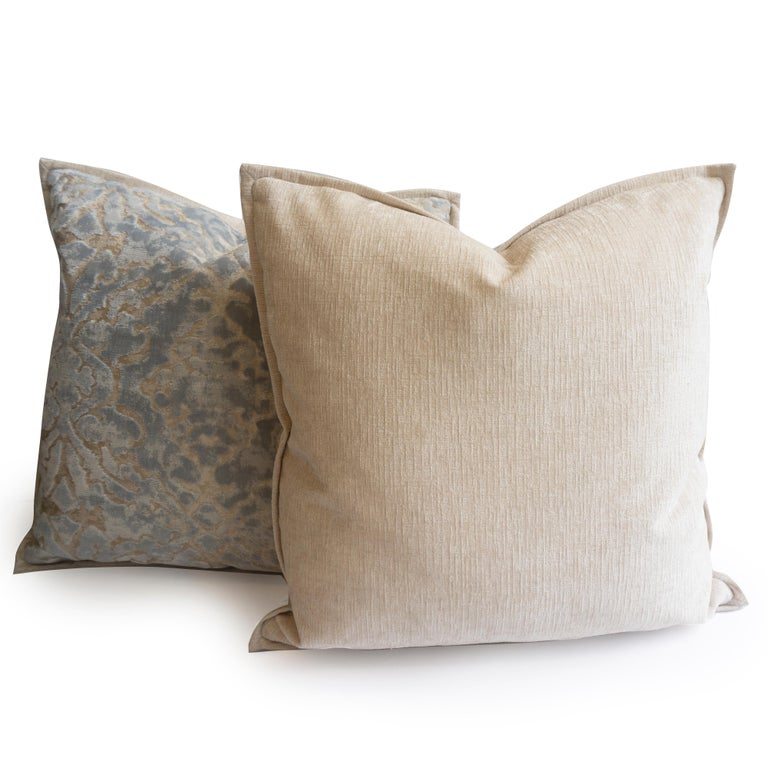 This pair of throw pillows were hand sewn at our studio in Norwalk, Connecticut. The pillows feature a light blue cut velvet damask pattern and beige back and flange.   Measurements: 20