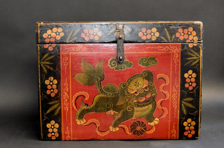 A wonderful, hand painted Tibetan box featuring a foo dog playing with ribbons and ball. Classic Tibetan border with flowers and bamboo leaves integrates Chinese style. Solid wood construction . Ample storage.