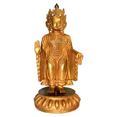 Tibetan Gilt Bronze No Fear Buddha, 20th Century