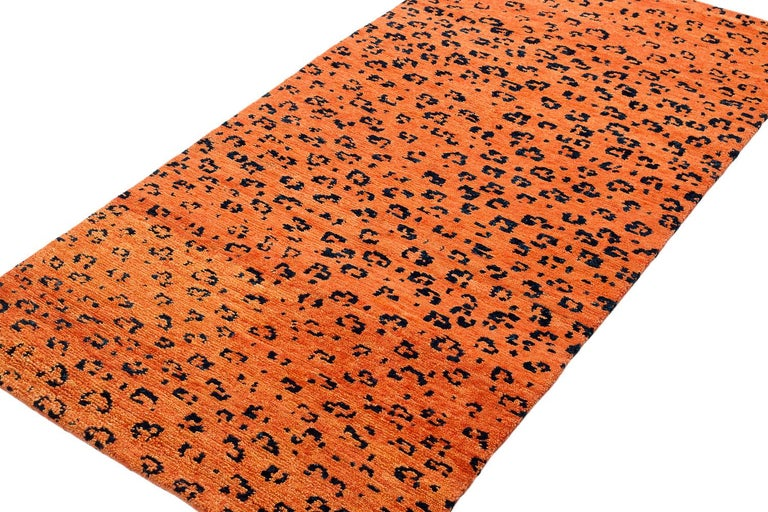 A bright orange contrasts against the strong black leopard dots in this Leopard print design. Handwoven in handspun Himalayan wool, Joseph Carini was inspired by the markings on one of the most majestic and elusive wild creatures, in a versatile 3'