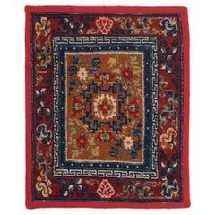 Tibetan Saddle Carpet with Floral Medallion, c. 1900