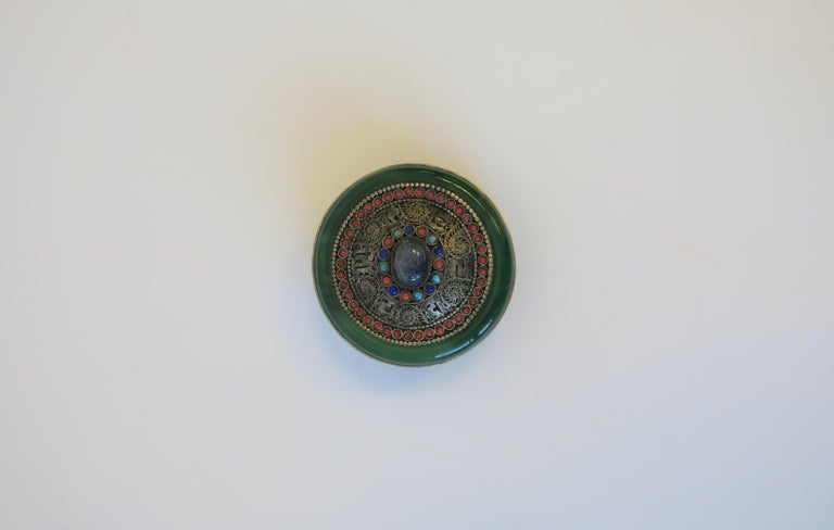 A round Tibetan sterling silver and be jewelled ceremonial box. A beautiful box for a vanity or desk area for jewelry, other items, or as a standalone decorative piece.  Box measures: 2.25