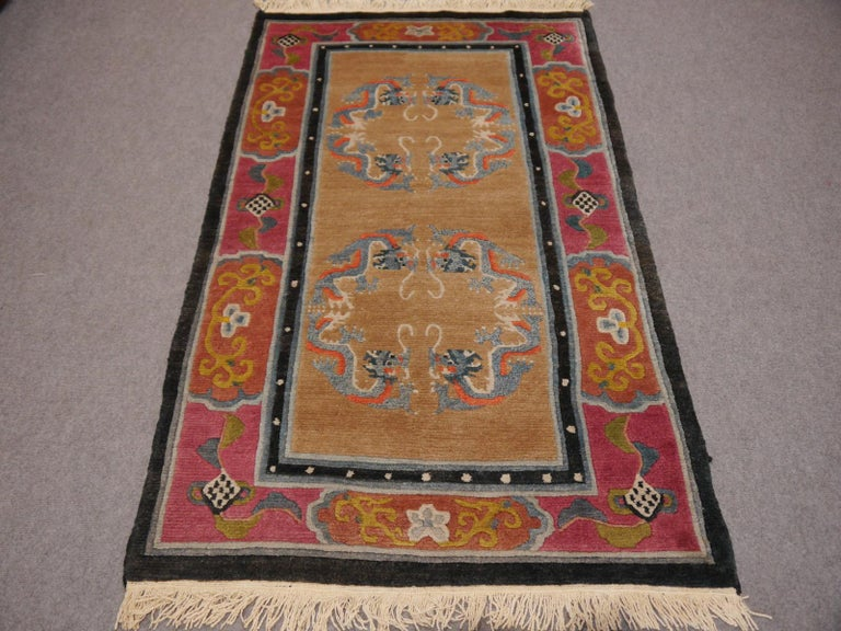 Vintage hand-knotted Tibetan meditation rug  This beautiful Tibetan rug was hand knotted using hand spun Tibetan highland wool - one of the finest wools available from sheep living above 9000 ft altitude. The size of the rug is traditional - these