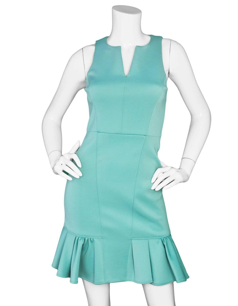 Tibi Sea Foam Green Sleeveless Dress Sz 0  Features flirty ruffle hem  Made In: China Color: Red Composition: 88% polyester, 12% elastane Lining: Black polyester Closure/Opening: Zip closure at back Exterior Pockets: None Interior Pockets: