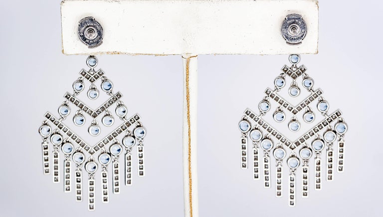 Pretty diamond, aquamarine and platinum chandelier earrings by Tiffany & Co. The earrings come from the Jazz Chevron collection by Tiffany, circa 2016-17. They feature round cut aquamarines of approx. 3-4 carats total weight, along with high grade