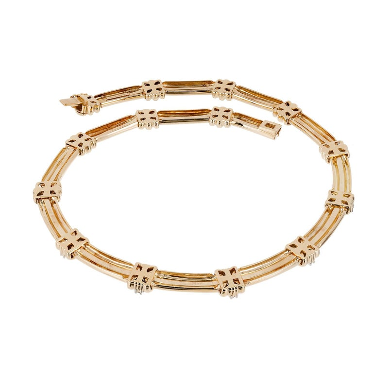 Tiffany & Co Atlas flexible link necklace in 18k yellow gold with platinum diamond sections   20 round full cut F-G VS diamonds approximate 1.00 carats Total Length: 16 inches 18k yellow gold Platinum 75.8 Grams Tested: 18k Stamped: PT 950