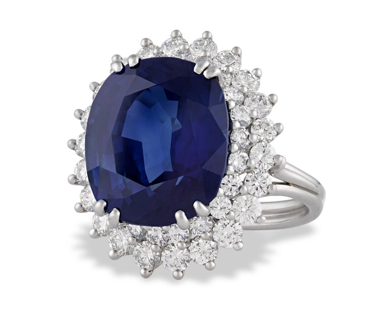 Centering this magnificent Tiffany & Co. ring is a breathtaking 10.93-carat sapphire certified by the American Gemological Laboratories to be of Ceylon (Sri Lanka) origin. With its stunning natural beauty and monumental size, this cushion-shaped,