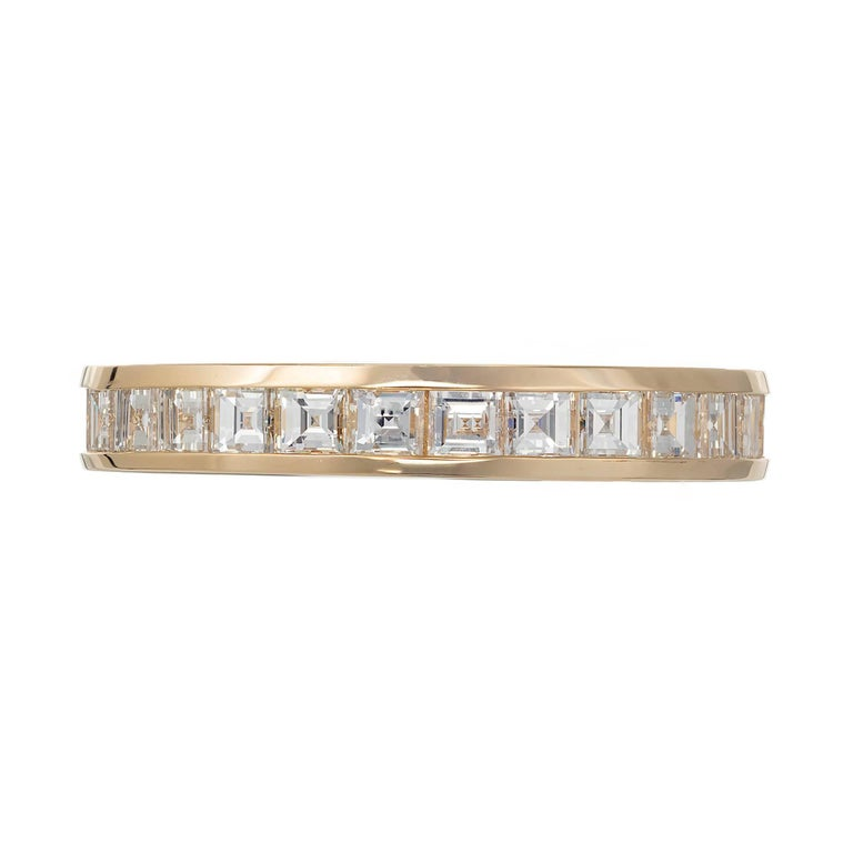 Authentic Tiffany & Co solid 18k yellow gold wedding band with channel set square diamonds.   28 2mm square diamonds, E - F  VVS1 - VS1, approx. total weight 1.70cts Size 8      Width: 3.5mm     Depth: 1.84mm     2.7 grams     Stamped: Tiffany + Co
