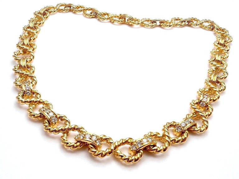 18k Yellow Gold Diamond Figure 8 Rope Link Necklace by Tiffany & Co.  With 30 round brilliant cut diamonds VS1 clarity and G color total weight approx. 0.60ct Details:  Length: 15