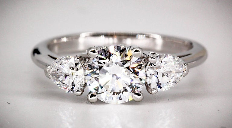 Timeless platinum-set diamond 3 stone engagement ring by Tiffany & Co. Diamonds are very high grade and rare, all of the highest color grade possible and very high clarity. Center stone is 0.80cts VVS1 clarity, D color. Size of side stones are .25
