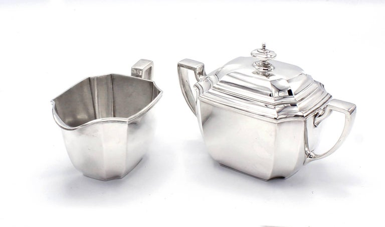 Tiffany & Co.  Hampton sterling silver coffee and tea in New York, circa 1912. This set comprises kettle on stand, coffeepot, teapot, creamer, sugar, waste bowl and hot coco server (Hampton Engraved).  Hallmark includes pattern no. 18389 (first