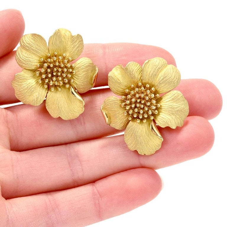 These captivating ca. 2000 dogwood flower Tiffany & Co. oversized earrings of enchanting aesthetic are crafted in a combination of 18-karat matted and yellow gold, weighing 35.9 grams and measuring 1.25 inches in diameter. The earrings are designed