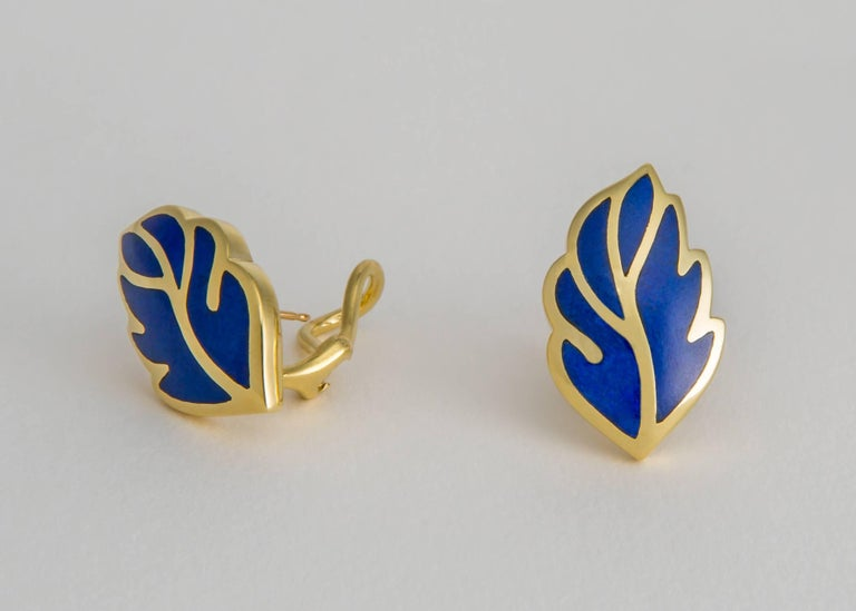 Rich lapis is inlayed in a soft easy to wear leaf shaped earring. Tiffany quality and design all the way. Approximately 1 inch in length.