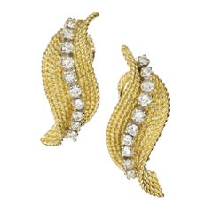 Tiffany & Co. .70 Diamond Gold Swirl Midcentury Earrings