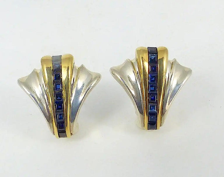 Stunning Art Deco Style Tiffany & Co. Sterling Silver, 14 Kt. yellow gold and Sapphire Fan Form Earrings. A lovely pair of earrings by Tiffany  & Company crafted of sterling silver having an Art Deco style fan design and featuring 18 emerald cut