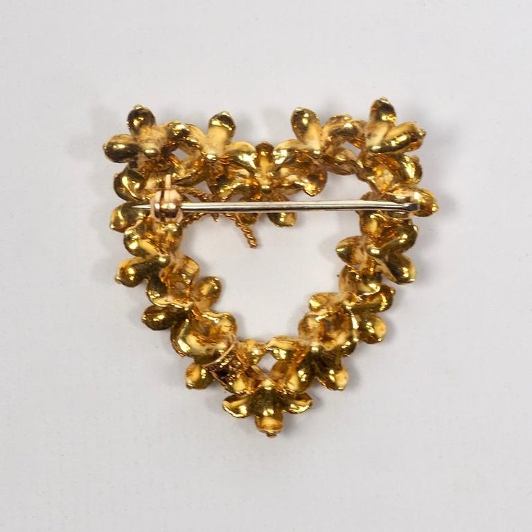 Tiffany 18 Karat Gold Floral Heart Brooch of delicately modelled flowers surmounted with a bow. Stamped Tiffany Italy 18K to back. 7.7 dwt.