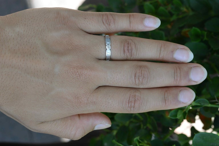 An iconic and very wearable Tiffany & Co.Atlas collection diamond solitaire engagement ring or band. Set in gleaming 18k white gold and centered by a dazzling round brilliant weighing 0.13 carat surrounded by Roman numerals, you can wear it alone or