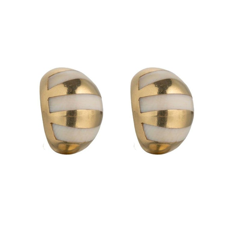 Tiffany and Co. vintage gold stud ear clips made in 18K gold.  Earring Details  Dimensions15 mm X 15 mm Gold18K Gold Weight15.4 grams