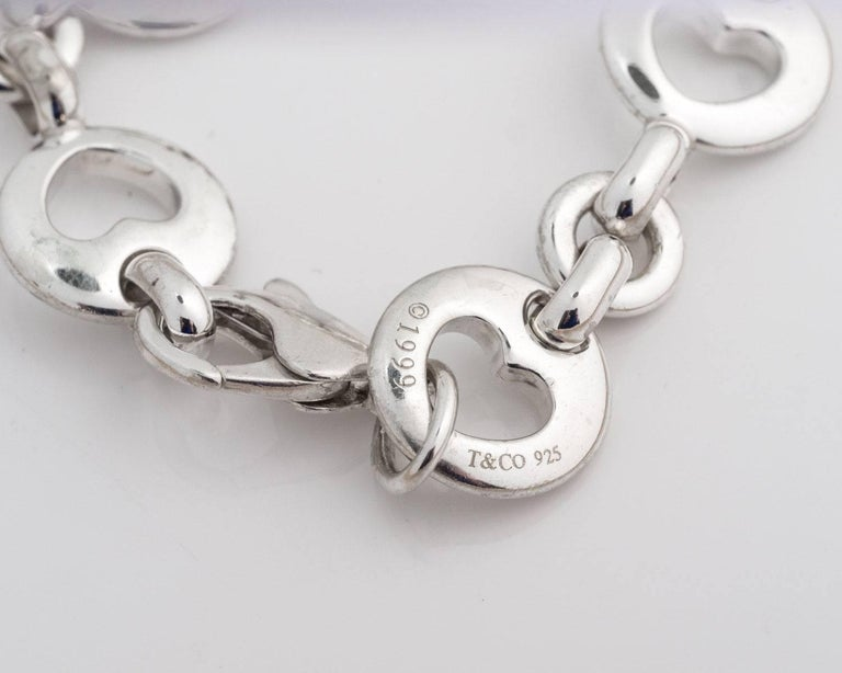 Tiffany and Co. Heart Cutout Link Charm Bracelet - Sterling Silver  In 1999 Tiffany and Co. made this Limited Edition bracelet along with other items for a turn of the century collection.  Each round link has a heart cutout in the middle. Three
