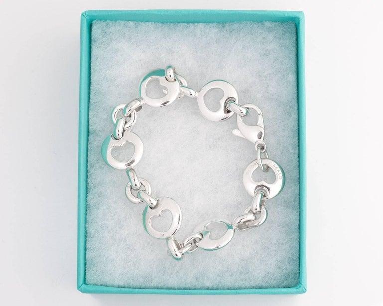 Modern Tiffany & Co. Heart Link Sterling Silver Charm Bracelet For Sale