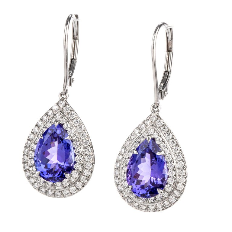 These Tiffany Diamond and Tanzanite  Earrings from Soleste collection  were inspired with a drop style dangle design and   crafted in Platinum.  The Stunning pear shaped Tanzanite are surrounded by a double  halo in white diamonds.  Diamonds weigh